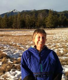 Sue Hawkins smiling in a field