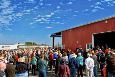 Large crowd of people outside a barn