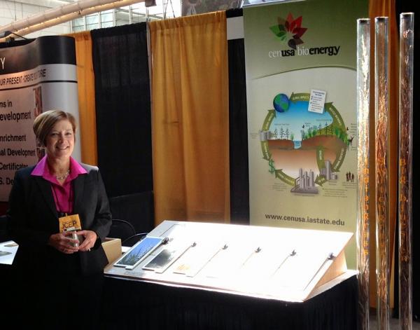 Jill Euken next to CenUSA Display